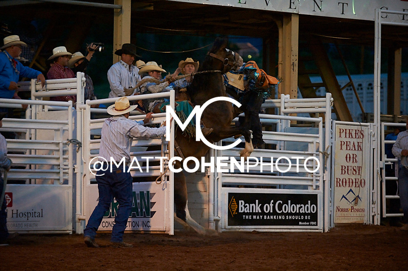 Saddle bronc rider Doug Aldridge of Carthage, MO rides Spring Creek at the Pikes Peak or Bust Rodeo in Colorado Springs, CO.<br /> <br /> <br /> UNEDITED LOW-RES PREVIEW<br /> <br /> <br /> File shown may be an unedited low resolution version used as a proof only. All prints are 100% guaranteed for quality. Sizes 8x10+ come with a version for personal social media. I am currently not selling downloads for commercial/brand use.