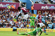 Idrissa Gana of Aston Villa hurdles over the tackle from Yann M'Vila of Sunderland. Barclays Premier League match, Aston Villa v Sunderland at Villa Park in Birmingham, Midlands on Saturday 29th August  2015.<br /> pic by Andrew Orchard, Andrew Orchard sports photography.