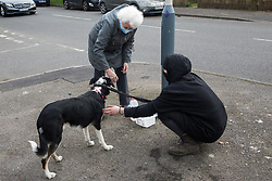Sipson, UK. 8th March, 2021. A local resident brings water for a dog during an operation by bailiffs from the National Eviction Team (NET), facilitated by the Metropolitan Police, to evict residents from the remaining section of a squatted off-grid eco-community garden known as Grow Heathrow. Grow Heathrow was founded in 2010 on a previously derelict site close to Heathrow airport in protest against government plans for a third runway and has since made a significant educational and spiritual contribution to life in the Heathrow villages which are threatened by airport expansion.