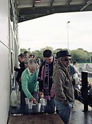 Half time and fans queue for tea and coffee from a snack bar during Dulwich Hamlet Vs Wealdstone football game on the 8th September 2018 at the KNK Stadium in South London in the United Kingdom. The KNK Stadium is Dulwich Hamlets temporary ground following eviction from their home ground, Champion Hill in March 2018.