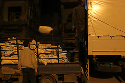 May 2, 2017 - Douma, Damascus, Syria - People unload supplies from a Syrian Arab Red Crescent (SARC) truck part of a SARC and UN aid convoy in the rebel-held town of Douma, on the eastern outskirts of Damascus, early on May 3, 2017. (Credit Image: © Samer Bouidani/NurPhoto via ZUMA Press)