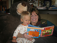 Grandma Cookie and Talus Book spend some time reading with a giant teddy bear photobomb