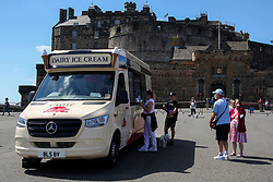 © Licensed to London News Pictures. 14/07/2021. Edinburgh, Scotland, UK. People queue for ice cream outside Edinburgh Castle on a hot and sunny day in Edinburgh as warm weather continues in Scotland. According to the Met Office, a high of 23 degrees celsius is forecast for the rest of the week. Photo credit: Dinendra Haria/LNP