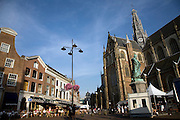 People sitting outside cafe Haarlem Holland