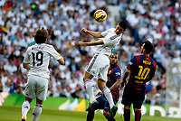 """Spanish  League""- match Real Madrid Vs FC Barcelona- season 2014-15 - Santiago Bernabeu Stadium - James Rodriguez(Real Madrid) and Lio Messi (FC Barcelona) in action during the Spanish League match(Photo: Guillermo Martinez / Bohza Press / Alter Photos)"
