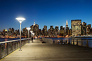 NYC midtown Skyline, United Nations and Empire State building at the blue hour, viewed from Gantry Plaza State Park, New York City, Long Island, Queens