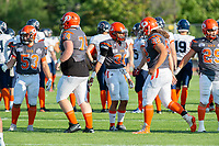 KELOWNA, BC - AUGUST 3:  Ryley Amendt #53, Michael Guirestante #36, Jackson Thomas #74 and JJ Heaton #62 of Okanagan Sun low five at the start of the game against the Kamloops Broncos  at the Apple Bowl on August 3, 2019 in Kelowna, Canada. (Photo by Marissa Baecker/Shoot the Breeze)