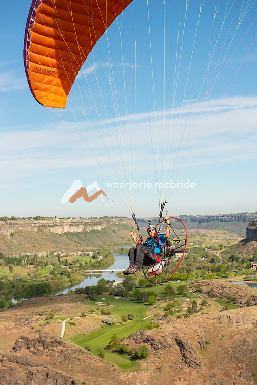 Miles Daisher professional base jumper paragliding in the Snake River Canyon near the Perrine Bridge and visitor center in Twin Falls, Idaho. MR