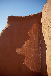 detail of an adobe wall in repair