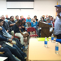 Jimmy Santiago Baca tells the stories behind some of his poems during a public reading to kick off the 2016 Gallup Author's Festival held at Octavia Fellin Library in Gallup Friday.