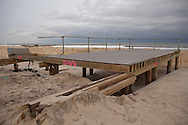 Point Pleasnt NJ November 15, A part of a boardwalk destroyed by superstorm Sandy remains standing.  Sandy's surge flooded thousands of homes in the tri-state area and knocked out power to millions. Sandy's strength is being blamed by many on climate change.
