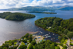 Aerial view of village of Balmaha  on shores of Loch Lomond in Loch Lomond and The Trossachs National Park, Scotland, UK