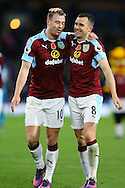 Ashley Barnes (l) and Dean Marney of Burnley celebrate their teams win at the end of the game. Premier League match, Burnley v Crystal Palace at Turf Moor in Burnley , Lancs on Saturday 5th November 2016.<br /> pic by Chris Stading, Andrew Orchard sports photography.