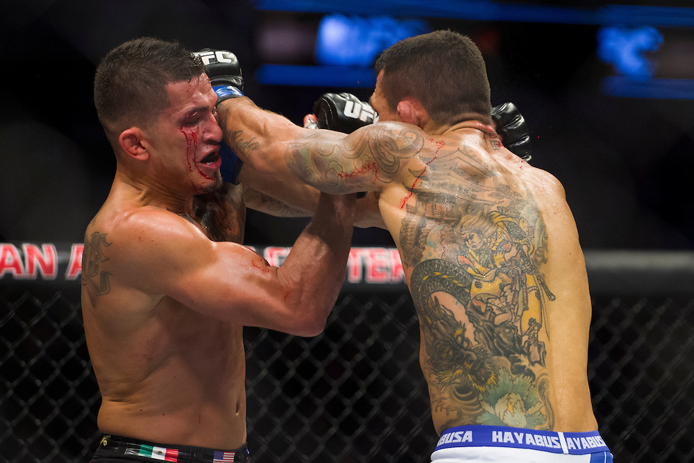 DALLAS, TX - MARCH 14:  Rafael Dos Anjos hits Anthony Pettis with an elbow during UFC 185 at the American Airlines Center on March 14, 2015 in Dallas, Texas. (Photo by Cooper Neill/Zuffa LLC/Zuffa LLC via Getty Images) *** Local Caption *** Rafael Dos Anjos; Anthony Pettis