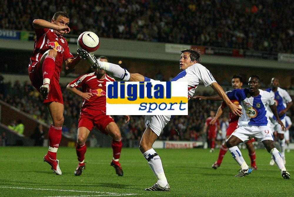 Photo: Paul Thomas.<br /> Blackburn Rovers v SV Red Bell. UEFA Cup. 28/09/2006.<br /> <br /> Morten Gamst Pedersen (R) of Blackburn wins the ball from Laszlo Bodnar.