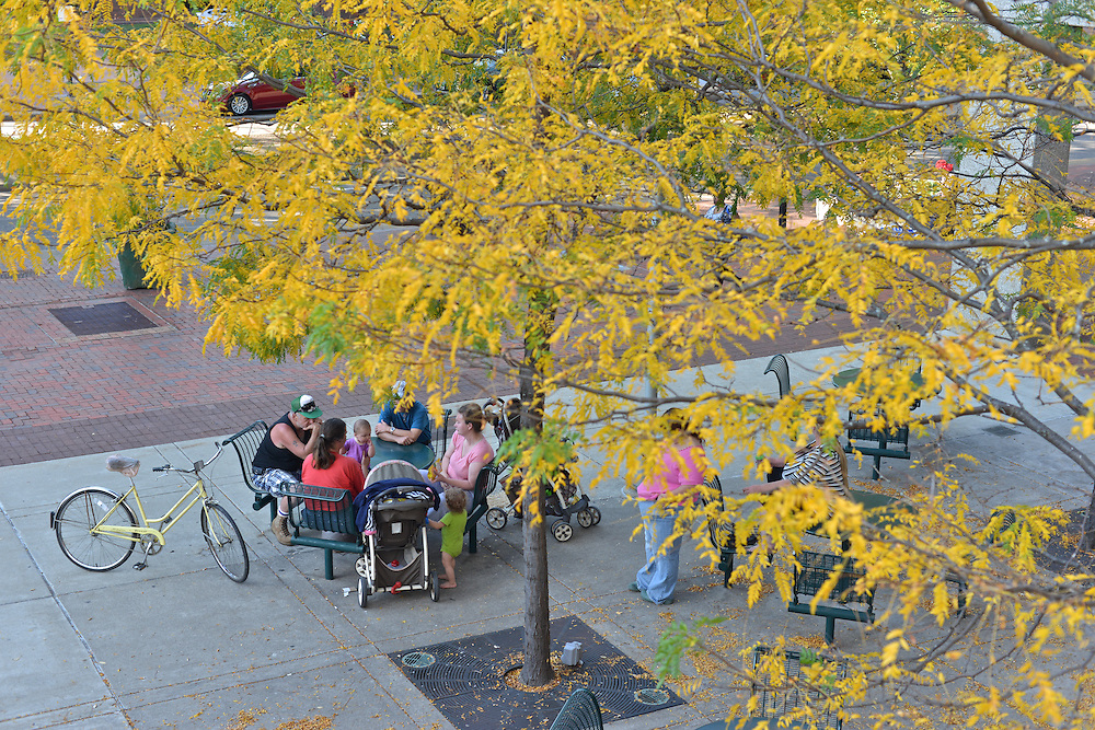 Residents sitting outside of the Akron-Summit County Public Library.