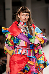© Licensed to London News Pictures. 07/06/2016. London, UK. A model presents a look by Megan Jane Mitchell from Edinburgh University.  Graduate Fashion Week, day three, takes place at the Old Truman Brewery in East London.  The event showcases the work of over 1,000 of the very best graduates from over 40 universities around the world through 22 catwalk shows and more.  Photo credit : Stephen Chung/LNP