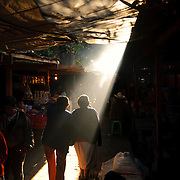 Sun streams down through a break in the covered markets in Chichi. Chichicastenango is an indigenous Maya town in the Guatemalan highlands about 90 miles northwest of Guatemala City and at an elevation of nearly 6,500 feet. It is most famous for its markets on Sundays and Thursdays.