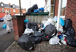 © under licence to London News Pictures. 06/01/2011. Mountains of waste piled up in Long Street, Sparkbrook, Birmingham today (06/01/2011). Some streets of Birmingham still remain filled with rubbish earlier today as the City Council struggle to clear rubbish left from before Christmas. Picture credit: Dave Warren/London News Pictures...