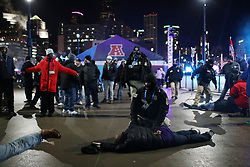 February 4, 2018 - Minneapolis, MN, USA - Police detain a man on the ground after another man was knocked unconscious during a fight as fans left U.S. Bank Stadium after Super Bowl LII on Sunday, Feb. 4, 2018 in Minneapolis, Minn. (Credit Image: © Anthony Souffle/TNS via ZUMA Wire)