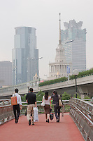 people cross road using pedestrian bridges in Shanghai China
