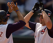 MORNING JOURNAL/DAVID RICHARD<br />Cleveland's Ben Broussard, right, is congratulated at home plate by teammate Victor Martinez after Broussard's 2-run home run in the seventh inning yesterday against the Royals.