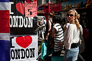 Tourists at a stall selling I Love London t-shirts.