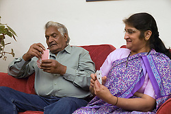Elderly Couple playing cards,