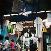 It is laundry day in the centre. All the girls are responsible for washing their own clothes and the wash house is busy. <br /> The Laura VicuÒa Centre in Cubao in Manila, the Philippines, houses 30 street girls who may be orphaned, neglected, abandoned, battered, morally endangered and abused.