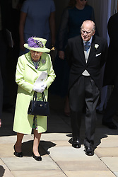 The Queen and Duke of Edinburgh walk to watch from the Galilee Porch as Prince Harry and Meghan Markle ride in an open-topped carriage through Windsor Castle after their wedding in St George's Chapel.