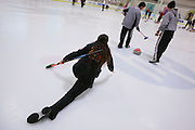 Gabrielle Coleman of Mountain View, left, delivers during the San Francisco Bay Area Curling Club's Tuesday night league at Sharks Ice in San Jose on Jan.15, 2013.