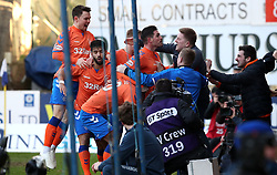 Rangers fans storm the pitch as Rangers' Alfredo Morelos (hidden) celebrates scoring his side's second goal of the game with team-mates during the Ladbrokes Scottish Premiership match at McDiarmid Park, Perth.