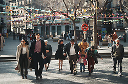 People walking through a square in Toledo; Spain,
