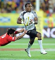 Fiji's Manasa Nayagi held by Portugal's Pedro Bettencourt at the IRB International Rugby Sevens, Westpac, Wellington, New Zealand, Friday, February 01, 2013. Credit:SNPA / Ross Setford