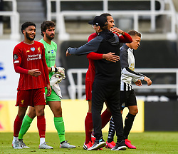 LIVERPOOL, ENGLAND - Sunday, July 26, 2020: Liverpool's Virgil van Dijk celebrates with manager Jürgen Klopp after the final match of the FA Premier League season between Newcastle United FC and Liverpool FC at St. James' Park. The game was played behind closed doors due to the UK government's social distancing laws during the Coronavirus COVID-19 Pandemic. Liverpool won 3-1 and finished the season as Champions on 99 points. (Pic by Propaganda)