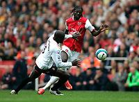 Photo: Tom Dulat.<br /> Arsenal v Sunderland. The FA Barclays Premiership. 07/10/2007.<br /> Nyron Nosworthy of Sunderland and Emmanuel Adebayor of Arsenal with the ball