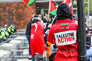 """London, United Kingdom, May 22, 2021: A member of """"Palestine Action: UK based actcist group attends a pro-Palestinian protest outside the Israeli Embassy in London on Saturday, May 22, 2021, as they take part in a rally supporting Palestinians. Egyptian mediators held talks on Saturday to firm up an Israel-Hamas cease-fire as Palestinians in the Hamas-ruled Gaza Strip began to assess the damage from 11 days of intense Israeli bombardment. Fresh clashes broke out at the Al-Aqsa Mosque compound in Jerusalem on Friday, just hours after a cease-fire between Israel and the Palestinian militant group Hamas took effect. (Photo by Vudi Xhymshiti/VXP)"""