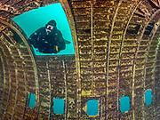 Scuba diver on the site of the Aircraft Challenger 600 at Dutch Springs, Scuba Diving Resort in Pennsylvania