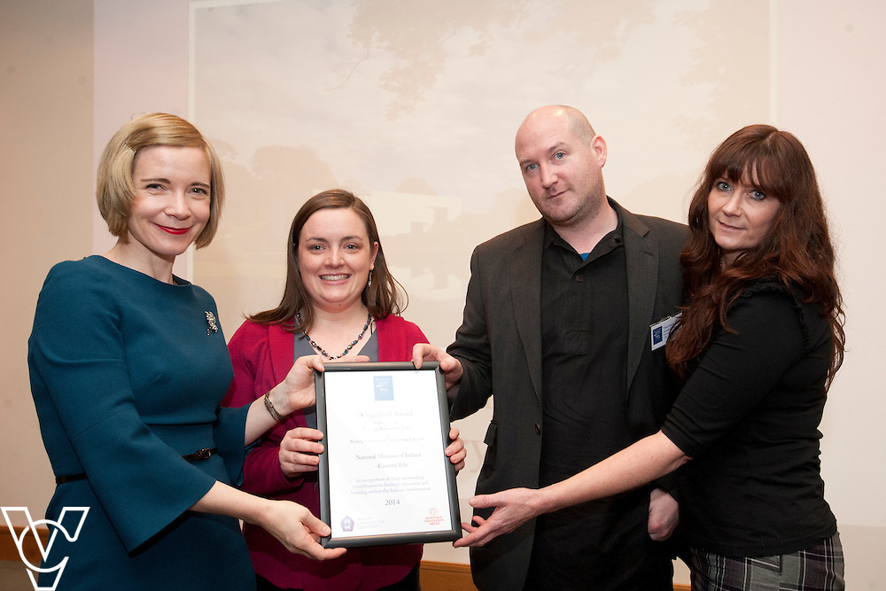 Chief curator of the Historic Royal Palaces, Dr Lucy Worsley presents an award to representatives from National Museum of Ireland – Country Life <br /> <br /> Sandford Awards 2014 ceremony held at the National Maritime Museum, Greenwich.<br /> Date: December 5, 2014<br /> <br /> Picture: Chris Vaughan/Chris Vaughan Photography