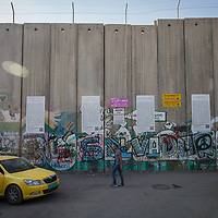 """A mural saying """"El Salvador"""" is painted on the Israeli separation wall in Bethlehem. The Israeli West Bank barrier or wall is a separation barrier in the West Bank. Israel calls it a security barrier while Palestinians and many others call it a racial segregation or apartheid wall. At a total length of 708 kilometres (440 miles) upon completion, the border traced by the barrier is more than double the length of the Green Line, with 15% running along it or in Israel, while the remaining 85% cuts at times 18 kilometres (11 miles) deep into the West Bank, isolating about 9.4% of it, leaving an estimated 25,000 Palestinians isolated from the bulk of that territory."""