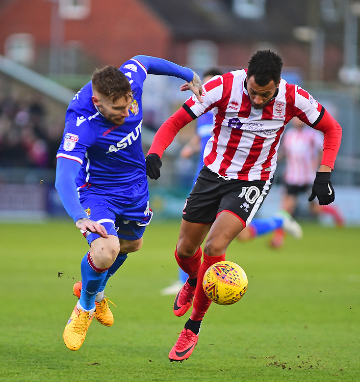 Lincoln City's Matt Green vies for possession with Stevenage's Jack King<br /> <br /> Photographer Andrew Vaughan/CameraSport<br /> <br /> The EFL Sky Bet League Two - Lincoln City v Stevenage - Tuesday 26th December 2017 - Sincil Bank - Lincoln<br /> <br /> World Copyright © 2017 CameraSport. All rights reserved. 43 Linden Ave. Countesthorpe. Leicester. England. LE8 5PG - Tel: +44 (0) 116 277 4147 - admin@camerasport.com - www.camerasport.com