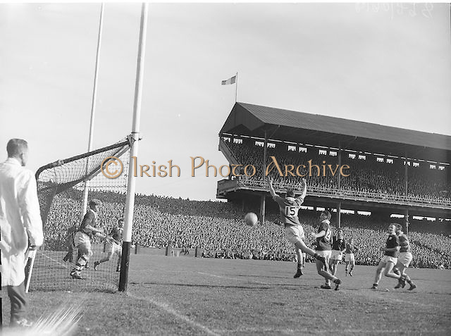 T Lyne Kerry left forward jumps and beats Galway defender J  Kissane, All Ireland Senior Gaelic Football Championship Final, Kerry vs Galway in Croke Park on the 27th September 1959. Kerry 3-7 Galway 1-4.