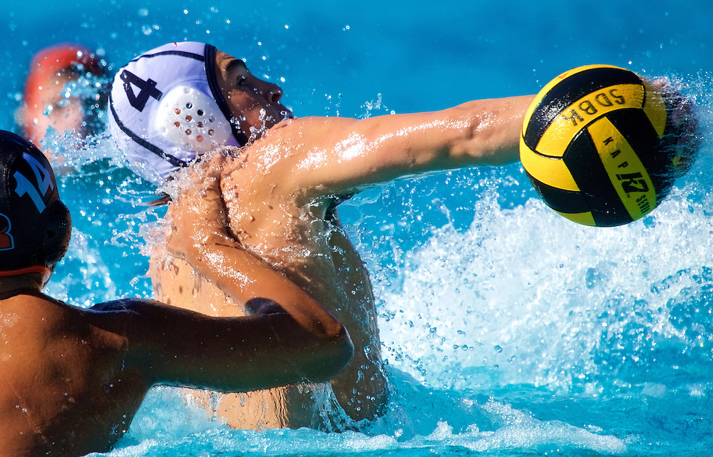 11/4/16 – Waterpolo – <br /> <br /> A Santa Ana player throws a backward pass over Riverside's Pedro Osorio during the OEC Water Polo Tournament at Saddleback College in Mission Viejo, Calif., Nov. 4, 2016.<br /> <br /> Photo by Seth Laubinger / Sports Shooter Academy