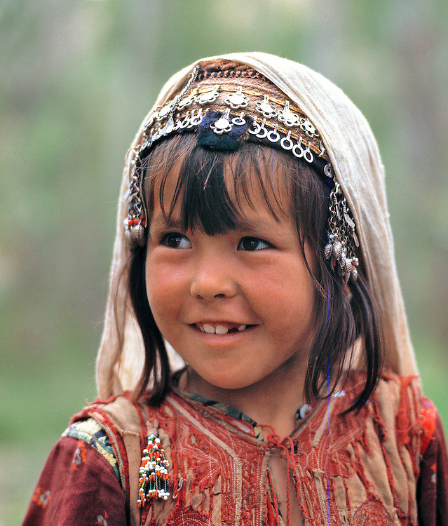 A young Afghan girl works with her family on the Shibar Pass in Northern Afghanistan.