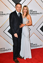 Phil Neville and wife Julie during the red carpet arrivals for the BBC Sports Personality of the Year 2018 at The Vox at Resorts World Birmingham.