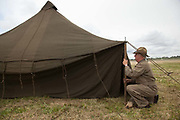 Living Historian raising tent at Warbirds Over the West at McNary Field.