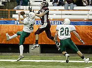 Cornwall's Donovan Rich (22) breaks up pass intended for Shawn Roe (24) of Corning East as Cornwall's Tim Brennan (20) looks on during the Class A state championship game in the Carrier Dome in Syracuse on Nov. 24, 2006.