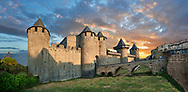 Carcassonne medieval historic fortifications and battlement walls of Carcassonne castle, Carcassonne France . The medieval citadel of Carcassonne, known as the Cité de Carcassonne, is a medieval fortress dating back to the Gallo-Roman period and restored by the theorist and architect Eugène Viollet-le-Duc in 1853. It was added to the UNESCO list of World Heritage Sites in 1997. The fortified city of Carcassonne consists essentially of a concentric design of two outer walls with 53 towers and barbicans to prevent attack by siege engines. Carcassonne  castle itself possesses its own drawbridge and ditch leading to a central keep. The walls of Carcassonne consist of towers built over quite a long period. One section is Roman and is notably different from the medieval walls.<br /> <br /> <br /> Visit our MEDIEVAL PHOTO COLLECTIONS for more   photos  to download or buy as prints https://funkystock.photoshelter.com/gallery-collection/Medieval-Middle-Ages-Historic-Places-Arcaeological-Sites-Pictures-Images-of/C0000B5ZA54_WD0s