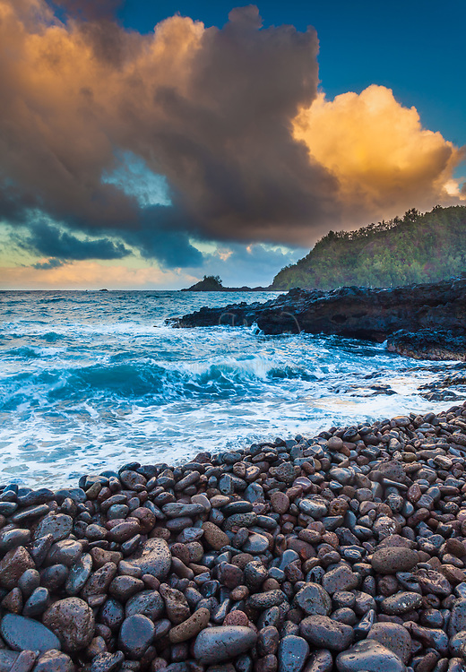 """Predawn glow over Hana Bay on the northeast coast of Maui, Hawaii, in the town of Hana<br /> .....<br /> The island of Maui is the second-largest of the Hawaiian Islands and is the 17th largest island in the United States. Maui is part of the State of Hawaii and is the largest of Maui County's four islands, bigger than Molokaʻi, Lānaʻi, and unpopulated Kahoʻolawe. Native Hawaiian tradition gives the origin of the island's name in the legend of Hawaiʻiloa, the navigator credited with discovery of the Hawaiian Islands. According to that legend, Hawaiʻiloa named the island of Maui after his son, who in turn was named for the demigod Māui. The earlier name of Maui was ʻIhikapalaumaewa. The Island of Maui is also called the """"Valley Isle"""" for the large isthmus between its northwestern and southeastern volcanoes and the numerous large valleys carved into both mountains."""