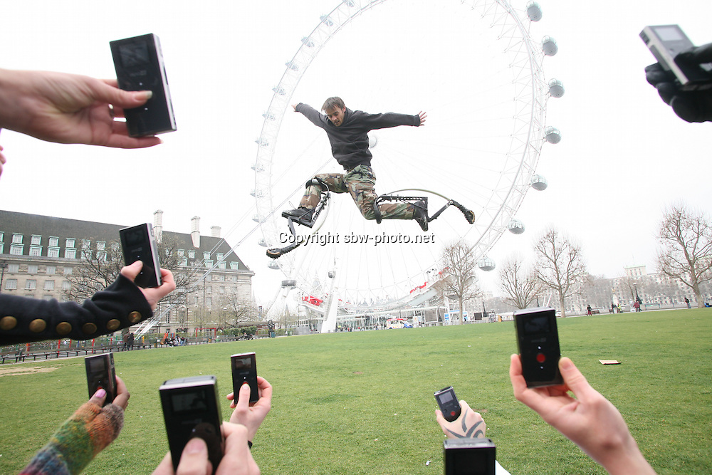 A street performer being filmed in front of the London Eye by a group of people using Flip Video MinoHD recorders which are launched today...Soaring Citizen Journalism: Brits record their own news.In the wake of eyewitness reports shaping the coverage of last week's G20, the meteoric rise of citizen journalism looks set to continue according to the latest research from Flip Video. The national survey found that while almost 4 in 5 people (77%) find the news more compelling when delivered through eyewitness reports, 14 percent of us have already recorded newsworthy events and shared the footage online.....For further information please call Paula Figgett at Kaizo PR - 02030434174